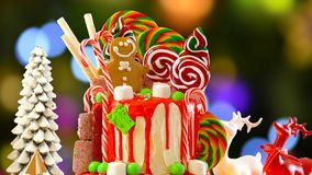 On trend Candy land Christmas drip cake. royalty free stock photo