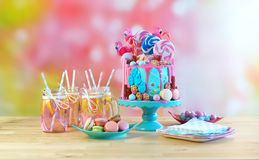 On trend candyland fantasy drip novelty birthday cake. On-trend candyland fantasy drip cake for children`s, teen`s birthday, anniverary, mother`s day and stock images