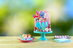 On trend candyland fantasy drip novelty birthday cake. On-trend candyland fantasy drip cake for children`s, teen`s birthday, anniverary, mother`s day and stock photography