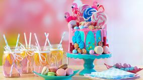 On trend candyland fantasy drip novelty birthday cake. On-trend candyland fantasy drip cake for children`s, teen`s birthday, anniverary, mother`s day and royalty free stock image