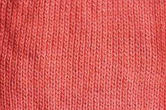 Trend color Living coral knitted background texture close up royalty free stock photo