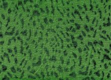 Green leopard fabric pattern texture. Trend fashion fabric texture. Leopard animal print backdrop for art work stock photography