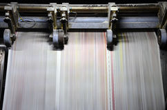 Trend Offset Printing. A large offset printing press running a long roll off paper at high speed royalty free stock photography