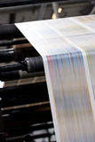 Trend Offset Printing. A large offset printing press running a long roll off paper over its rollers at high speed stock photos