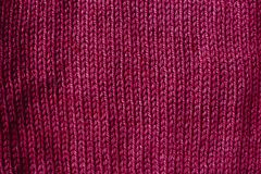 Trend red pear woolen knitted background, texture, close-up. The trend red pear woolen knitted background, texture, close up stock image
