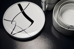 Trend tableware. Set of modern black and white tableware Stock Photos