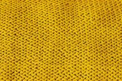 TrendCeylon gul woolen stucken bakgrund, textur, närbild royaltyfria bilder