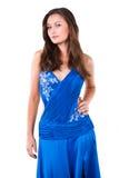 Trendig flicka i den blåa kappan som isoleras på white Royaltyfri Foto