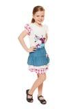 Trendig liten gullig flicka i skjortan och kjolen, full längd som isoleras på vit bakgrund royaltyfria foton