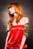 trendig röd kvinna för härlig klänning Royaltyfria Bilder