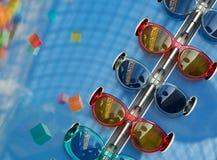 Trendig solglasögon av olika modeller på blå bakgrund royaltyfria bilder