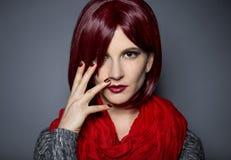 Trendigt rött spikar polermedel Fotografering för Bildbyråer