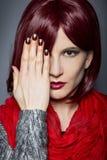 Trendigt rött spikar polermedel Royaltyfria Bilder