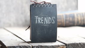 Trends concept, chalk inscription. Trends text, chalk inscription on the board, gray background stock footage