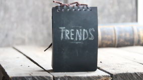 Trends concept, chalk inscription. Trends text, chalk inscription on the board, gray background stock video footage