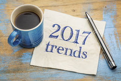 2017 trends concept on napkin with coffee. 2017 trends concept - handwriting on a napkin with a cup of coffee stock images