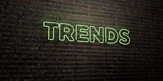 TRENDS -Realistic Neon Sign on Brick Wall background - 3D rendered royalty free stock image Stock Photography