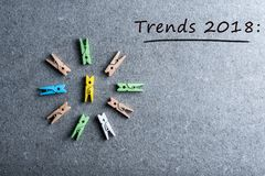 Trends 2018. what to expect from next year. Memo at dark background with many wooden pins. Mockup with empty space for Stock Images
