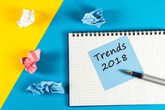 Trends 2018. what to expect from next year. Memo at yellow and blue background with notepad. Mockup with empty space for Royalty Free Stock Image