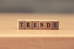 Trends. word written on wood block, vintage retro color tone Stock Images
