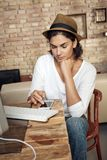 Trendy adult woman working at home Stock Photo