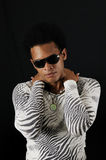Trendy african male. Portrait of young trendy african american male model posing isolated royalty free stock image