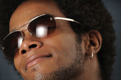 Trendy african man. Portrait of young trendy african man wearing sunglasses Royalty Free Stock Image