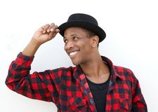 Trendy african man smiling with hat Royalty Free Stock Images