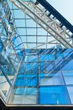 Trendy architecture with blue glass panels in a metal construction stock photography
