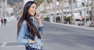 Trendy attractive young woman in a denim outfit Royalty Free Stock Images