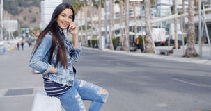 Trendy attractive young woman in a denim outfit Stock Image