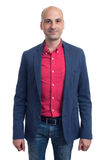 Trendy bald man in red shirt and blue jacket Stock Photos