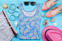 Trendy beach clothing for lady. Set of bright female accessories for vacation Stock Images