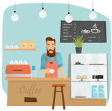 Trendy bearded barista making coffee in coffeeshop Stock Photography