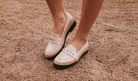 Trendy beige feminine loafers. Womens shoes.  stock images