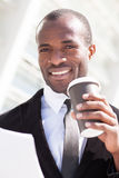 Trendy black man have coffee break. Outdoors Royalty Free Stock Photography