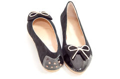 Trendy Black pair of ballet flats on white background. Royalty Free Stock Photography
