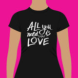 Trendy Black Shirt with All You Need is Love Texts Stock Photo