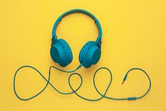 Free Trendy Blue Headphone On Yellow Background. Music Concept. Royalty Free Stock Photos - 196477208
