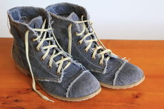 Trendy blue jeans boots Royalty Free Stock Photo