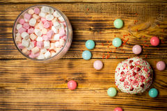 Trendy blue pink marshmallows, sweet cake, candies on wooden table Royalty Free Stock Image