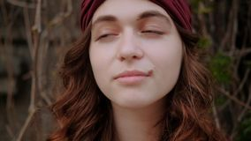 Trendy boho lifestyle woman portrait ginger curls. Trendy boho lifestyle. Cute young woman portrait. Ginger curls and a headband. Sliding shot stock video footage