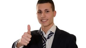 Trendy boy doing thumb-up sign over white background stock video footage