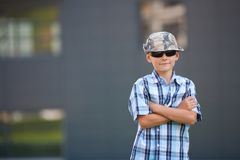 Trendy boy with hat and sunglasses Royalty Free Stock Photo