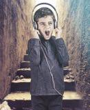 Trendy boy with headphones Stock Photo