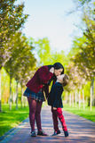 Trendy boy kissing his stylish mother outdoor. Stylish trendy boy and women or son with mother posing outdoor Stock Image