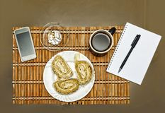 Trendy breakfast, Breakfast, business man, Smartphone, notebook,. Trendy breakfast. Breakfast is a business man. Smartphone and notepad, scheduling a daily routi stock photography