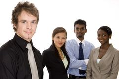 Trendy Business. A trendy young businessman standing in front of a diverse business group Stock Photos