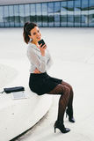 Trendy business professional woman texting message on smartphone Stock Photos
