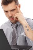 Trendy businessman with tattoo Stock Images